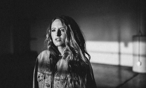 Emily Hackett Shines on Inspired Version of 'Happy Xmas'