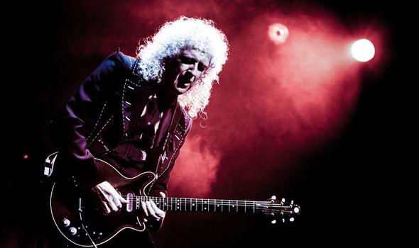 Brian May playing guitar