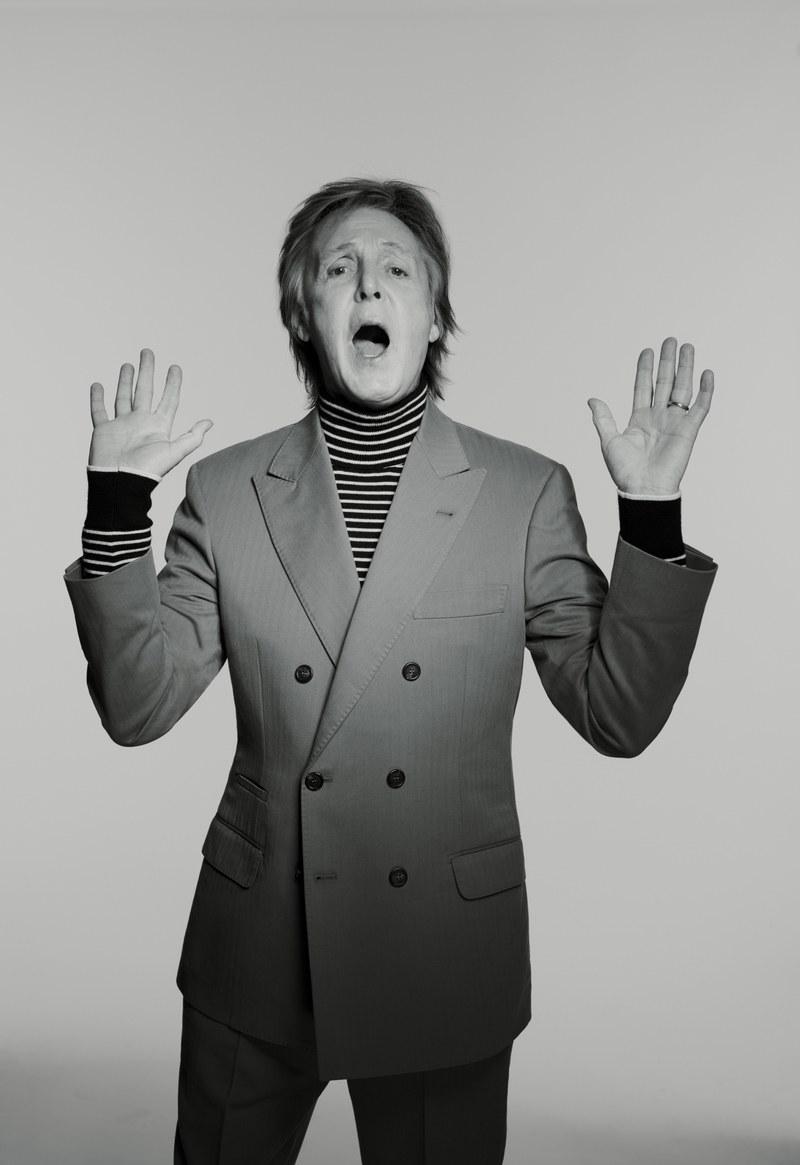 Paul McCartney having his hands raised.