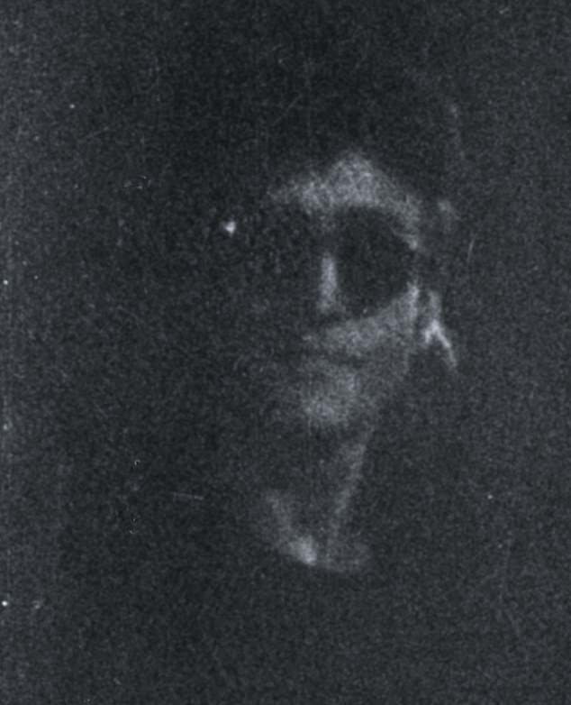 After signing the record album, John Lennon turns to the camera just as Goresh's flash fails, providing a ghostly black-and-white image