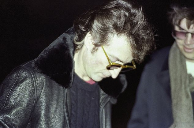 John Lennon is photographed for the last time signing a record album for his killer, Mark David Chapman at4pm on December 8, 1980, in New York