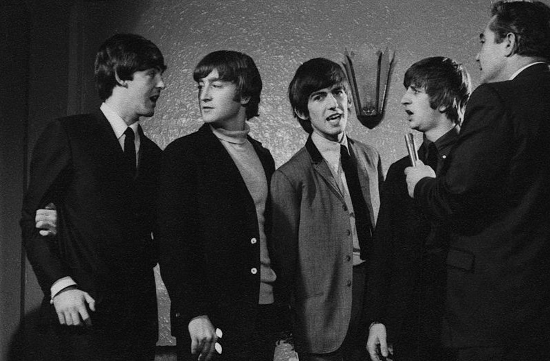The Beatles talk to the press in 1964