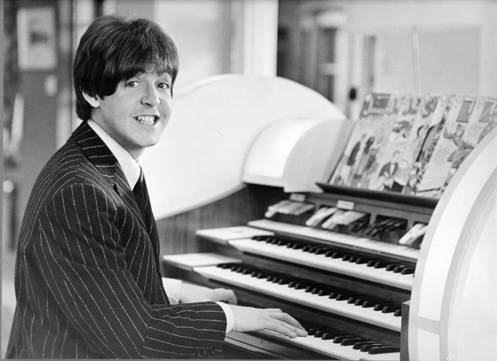 Paul McCartney playing a paino