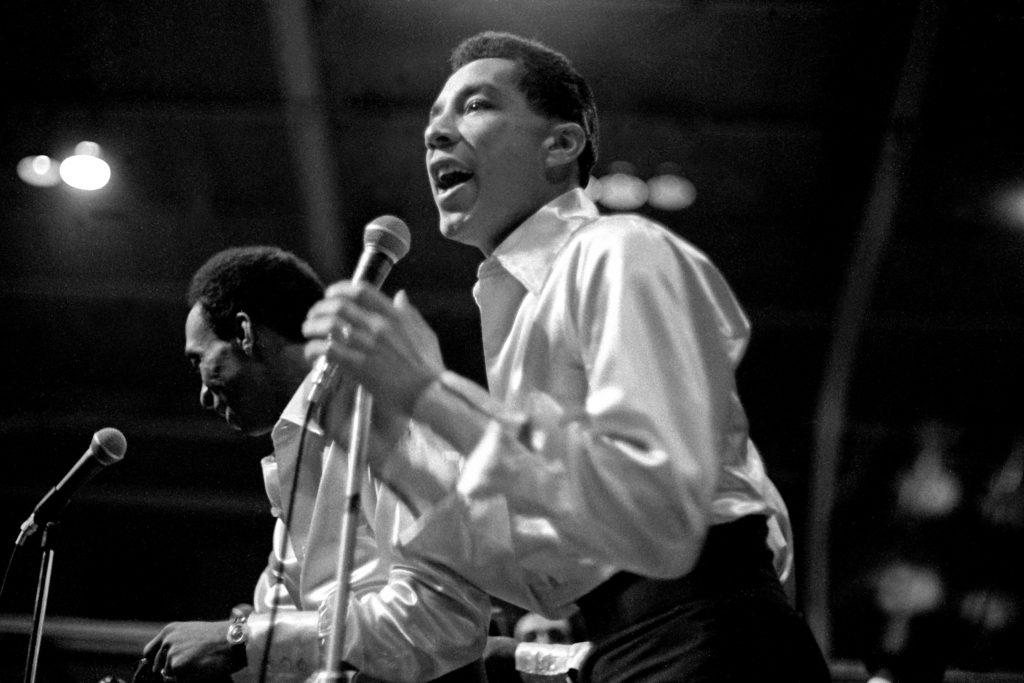 Smokey Robinson holding a microphone